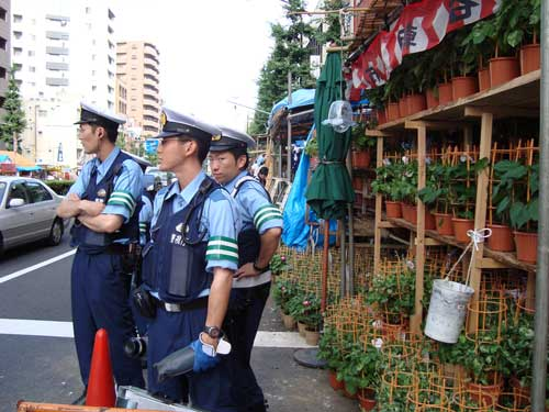 Police at Iriya morning glory festival